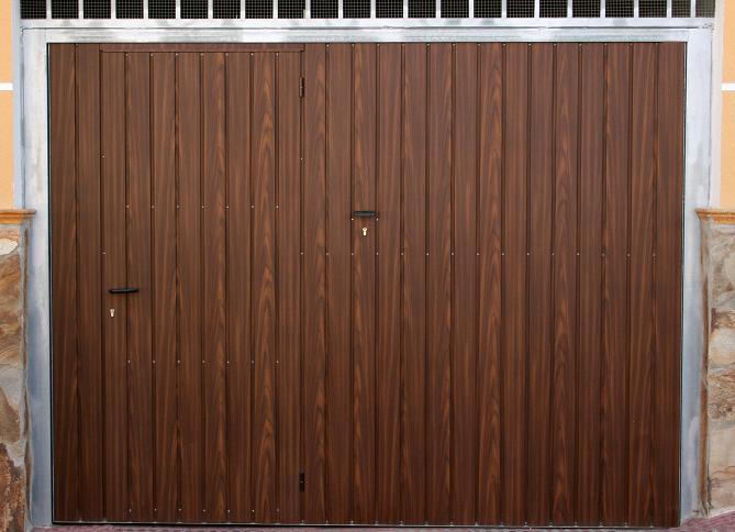 Toy sistemas cierres de seguridad puertas de garaje for Puertas abatibles garaje